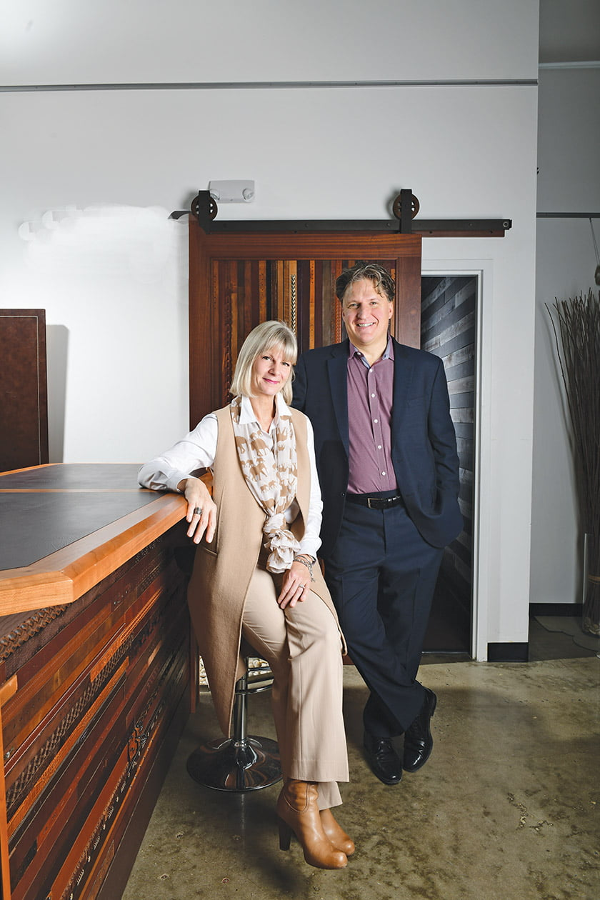 In their showroom, Bernice and Christian Nadeau showcase a wall and bar front of recycled leather belts.