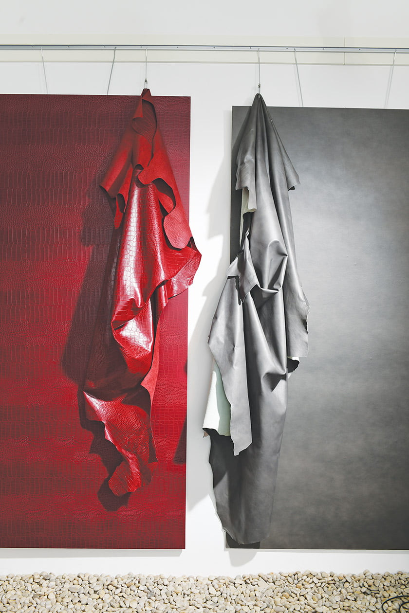 A display shows the resemblance between recycled-leather panels and hide leather samples.