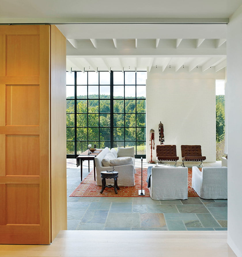 A barn door built into the custom bookshelves closes Matthew's study off from the great room.