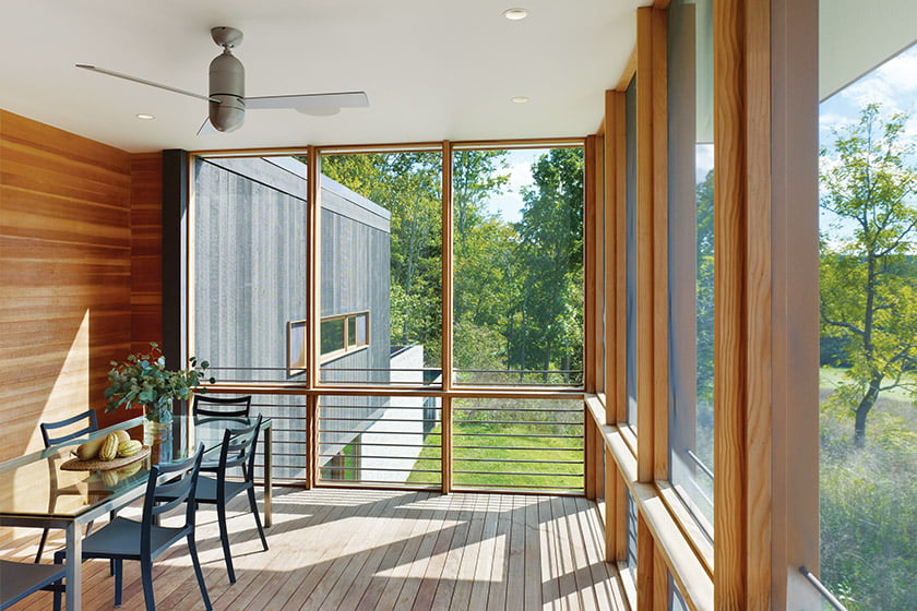 A door trimmed in Douglas fir opens to the screened porch.