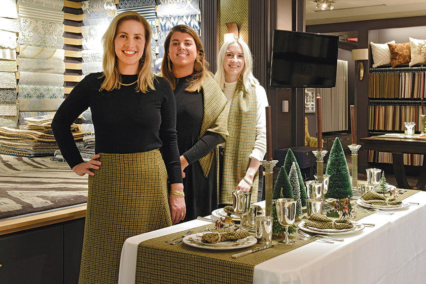 Holland & Sherry staff members Michelle Loomis, Marley Obrecht and Callie Wortham with décor by Hammock Hill Design.