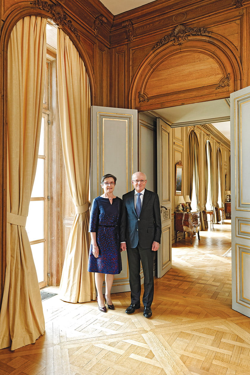 Ambassador Dirk Wouters and his wife, Katrin Van Bragt, pose in the library.