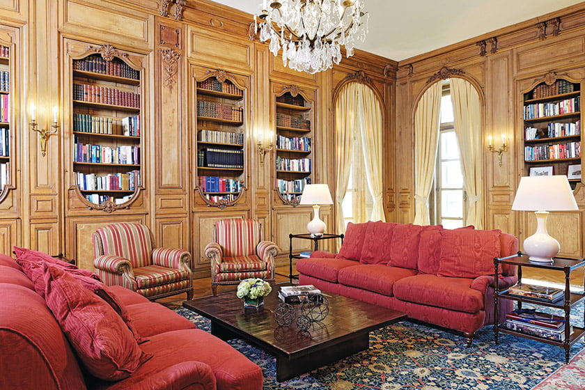 Regency-style oak paneling distinguishes the library, which contains each ambassador's books.