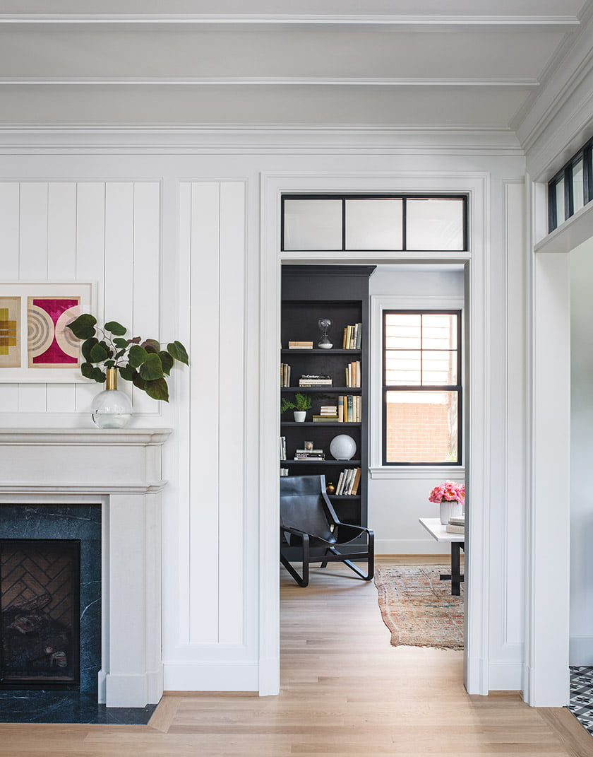 A cased opening with a transom offers a peek into the library.