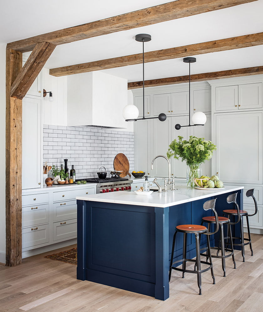 The kitchen embraces such classic elements as glazed backsplash tiles, a soapstone sink and brass hardware.
