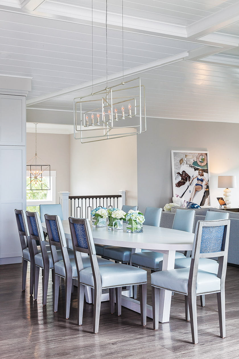 A light, sculptural Currey & Company chandelier makes a statement in the dining area.