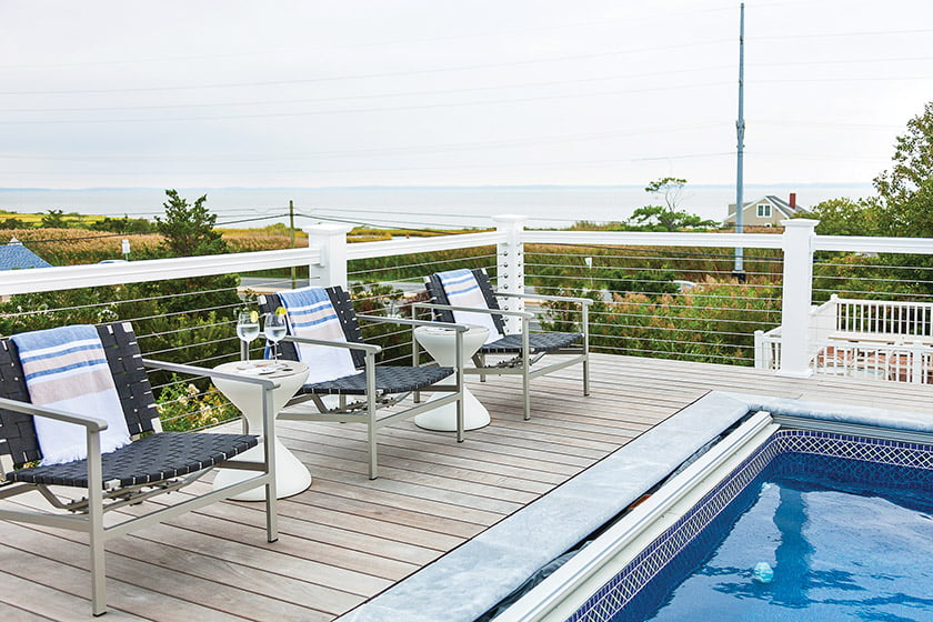 The pool deck boasts Brown Jordan outdoor furniture and enjoy views of the bay.