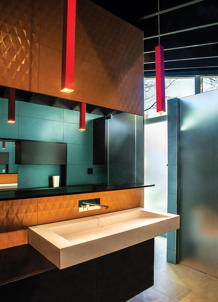 In the addition's new bathroom, Artemide light fixures from Illuminations hang over a Badeloft sink.