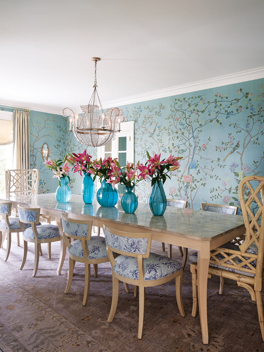 The dining room features hand-painted wall covering by de Gournay and a Niermann Weeks chandelier.