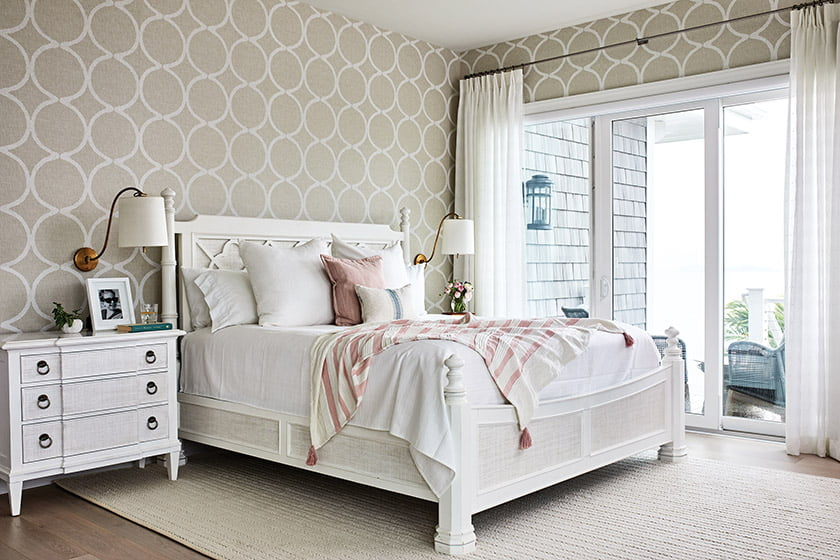 The main-level master bedroom boasts Thibaut grass-cloth wall covering and access to a private patio.