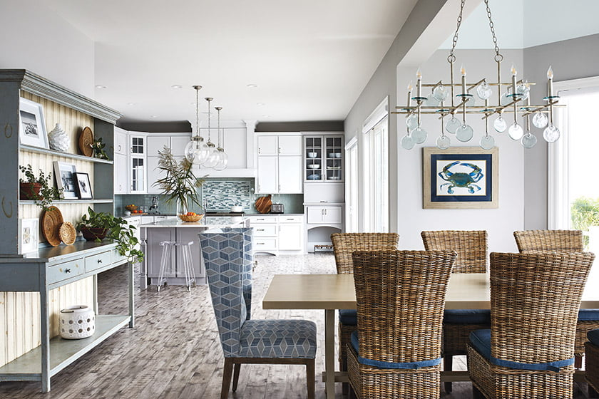 A Tritter Feefer table in the dining area is paired with a Currey & Company chandelier is adorned with sea glass.
