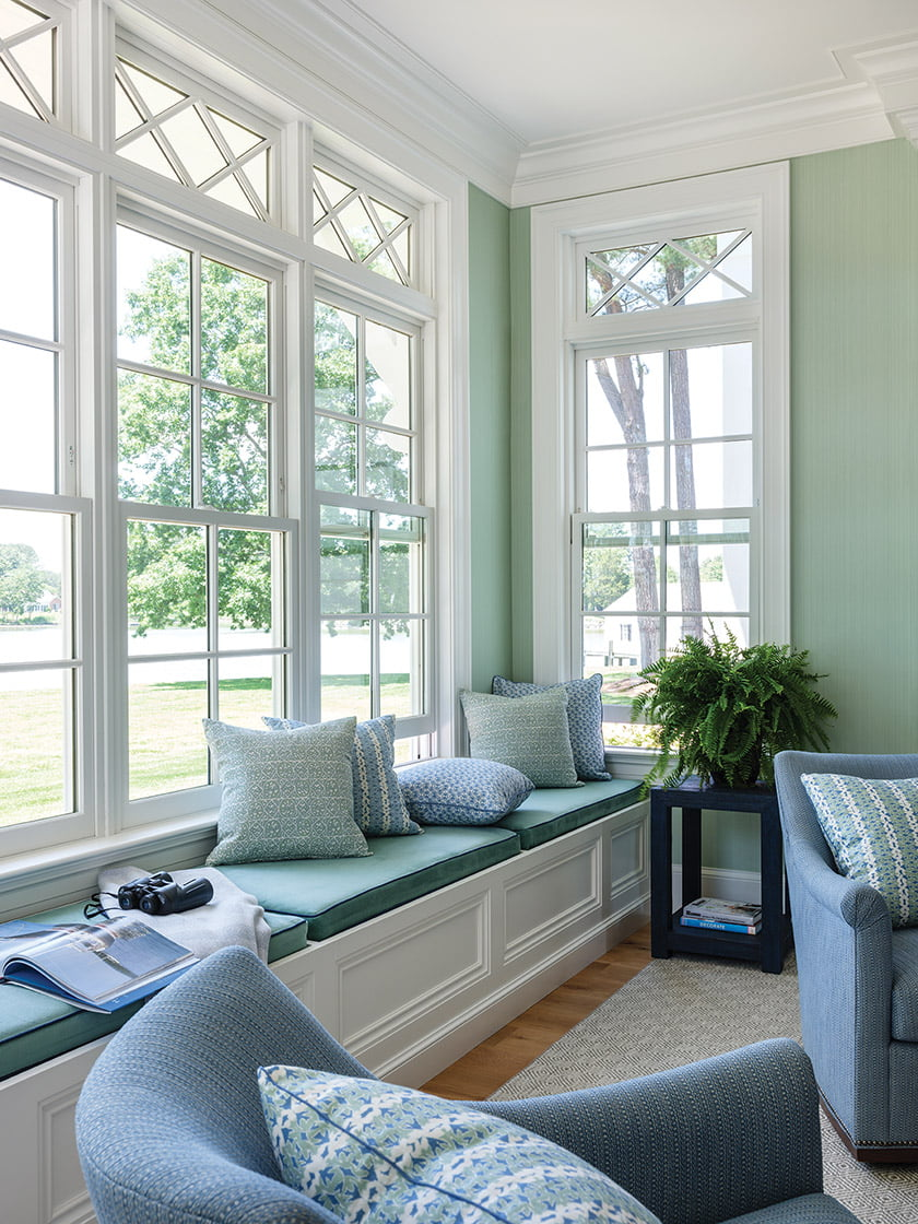 The window-bench pillows are covered Dove Stripe, Pompeii and Roman Fig—also from Meyer's collection.