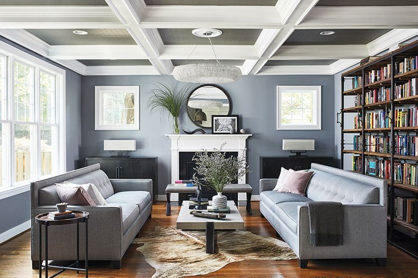 Benjamin Moore's Pewter covers the walls of the family room; Kaplan designed the twin sofas.