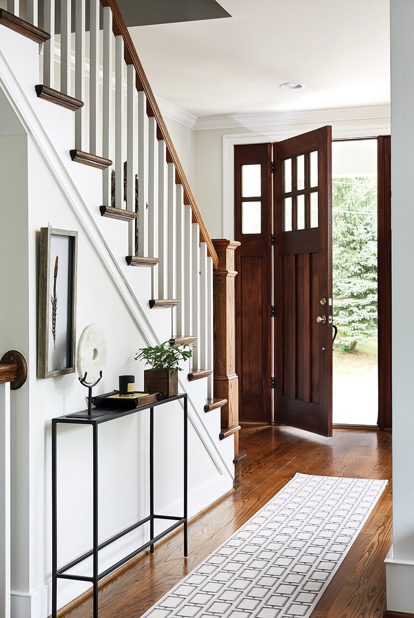 A narrow iron console from Room & Board graces the front hall.