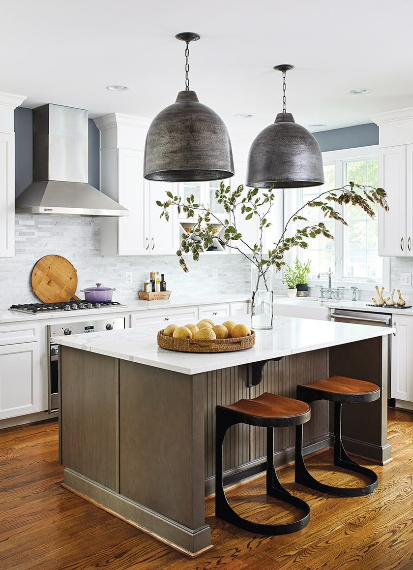 Currey & Company pendants create a focal point in the kitchen.