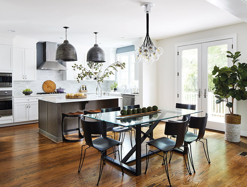 Oak floors, stained a rich brown hue, unify the kitchen and breakfast area.