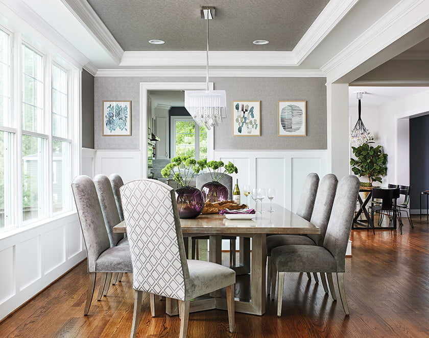 The dining area features a custom alder wood table and chairs upholstered in velvet and Pindler fabric.