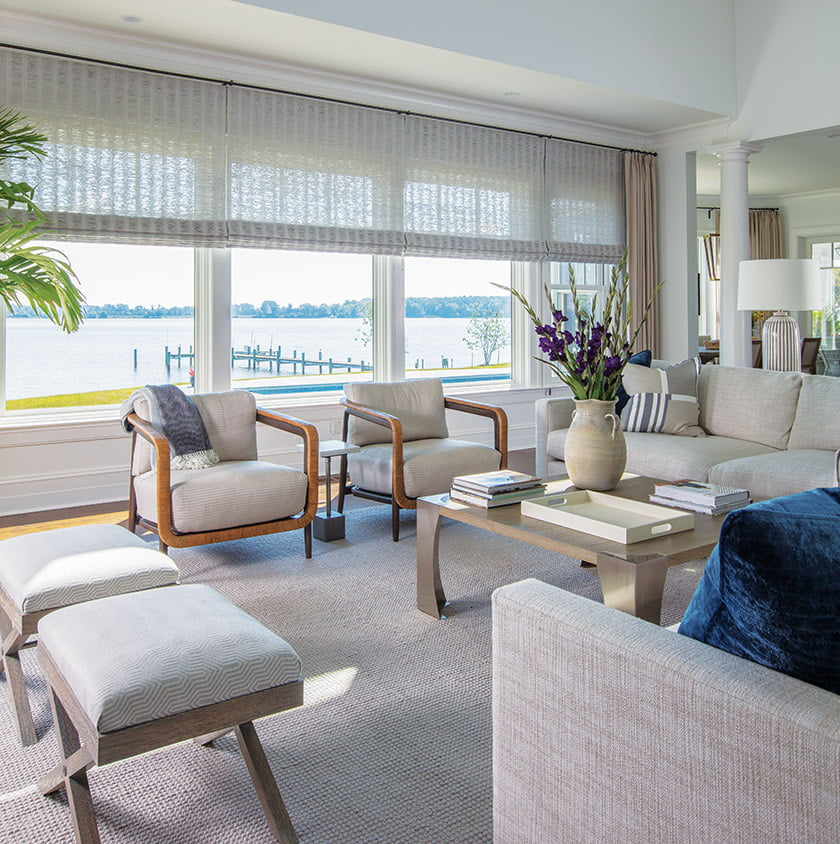 Neutral furnishings in the great room allow views of the Miles River to take center stage.