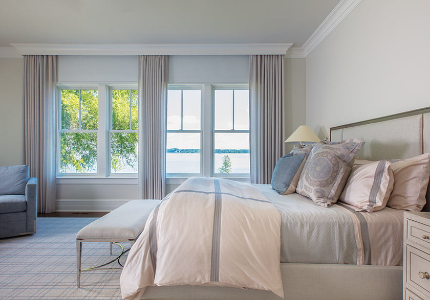 The soothing master bedroom is a study in blues and grays.