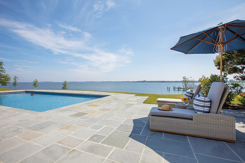 The new pool and Pennsylvania bluestone terrace enjoy long views of the river.