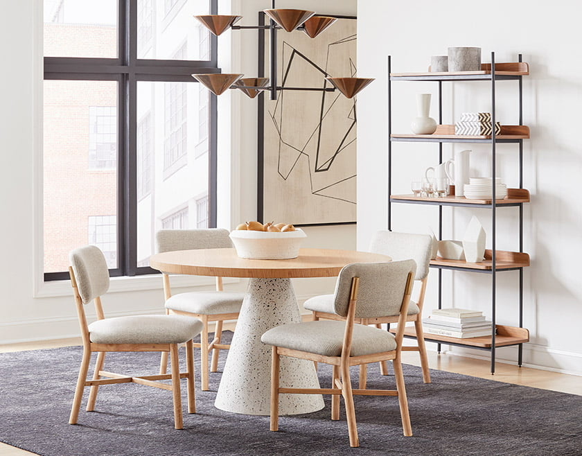 A vignette groups the Arne Dining Table, Bryde Side Chair and metal-framed Tove Etagere.