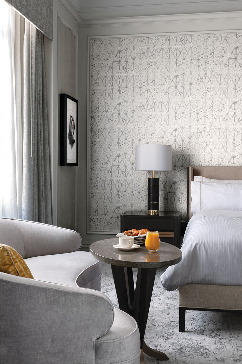 Layered and refined textures create a serene and tranquil vibe in one of the Chairman's Suite bedrooms.