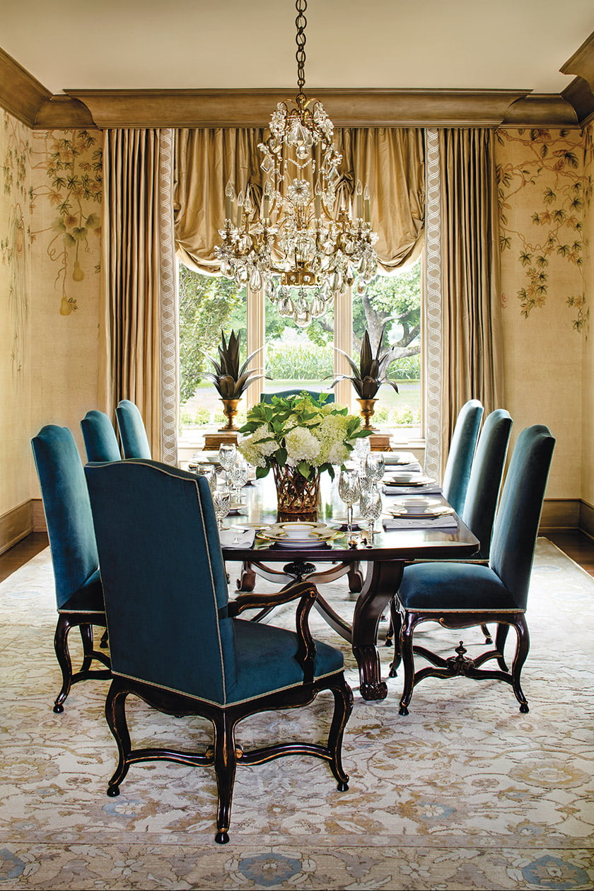 A chandelier from Jones Lighting Specialists illuminates the dining room.