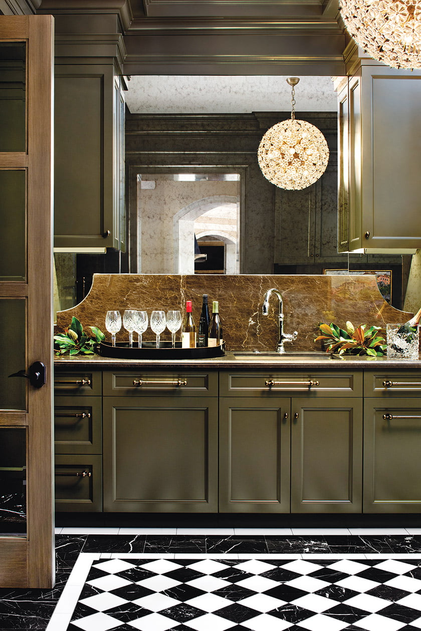 The custom butler's pantry cabinets are painted in Benjamin Moore's Aegean Olive.