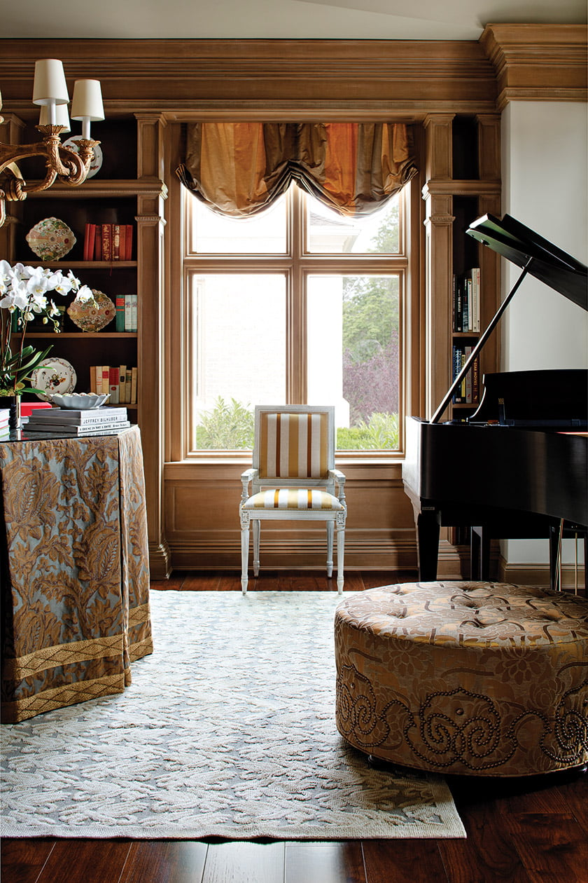 Opulent textiles embellish the music room, featuring an ottoman from J. Lambeth.