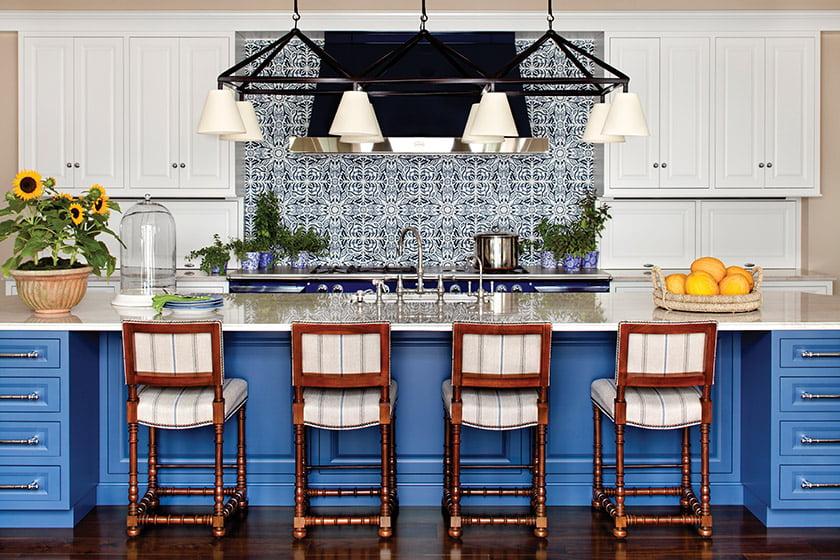 In the kitchen, concrete Lili tiles are a backdrop to the La Cornue range.