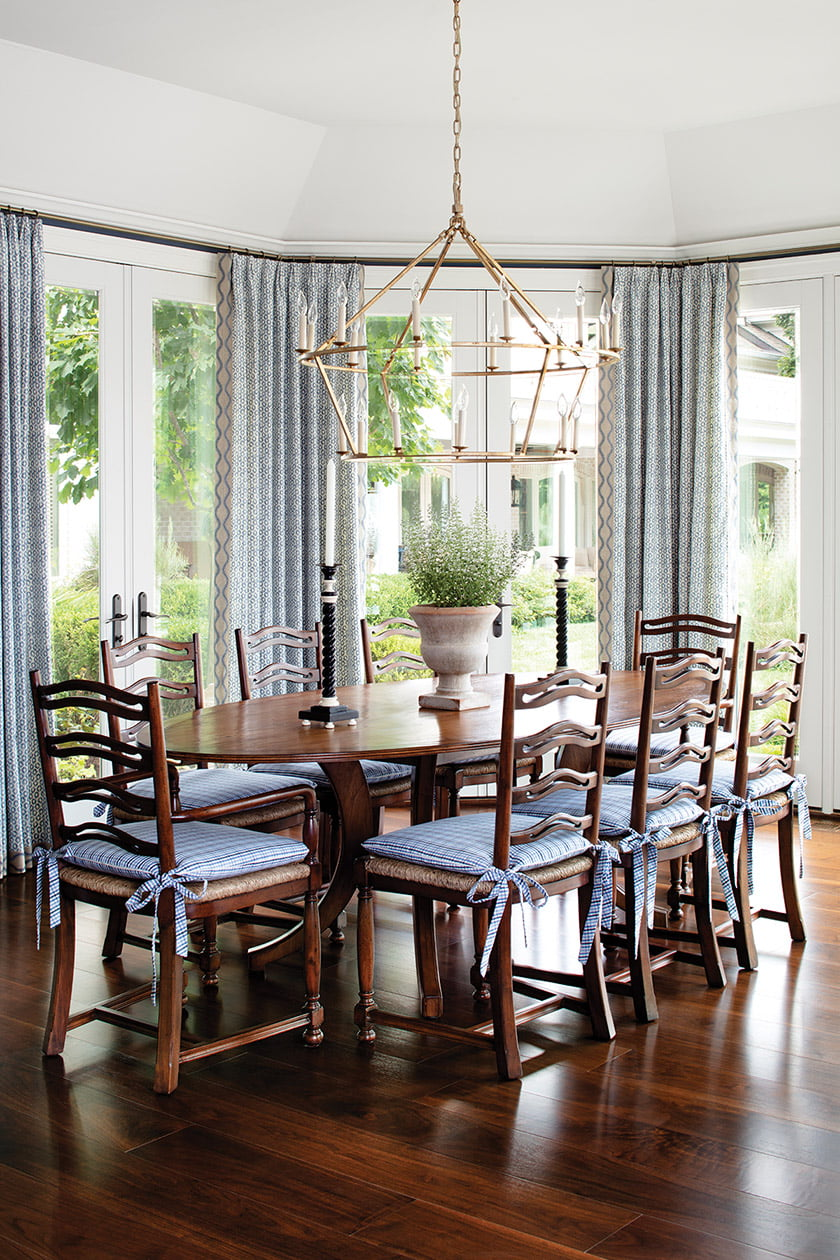 The breakfast room pairs a Woodland Furniture table with Jonathan Charles chairs.
