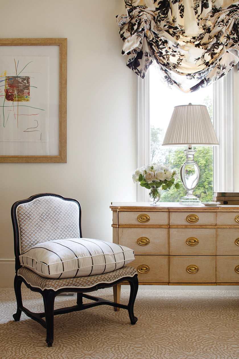 A chest of drawers by Mitchell Yanosky doubles as a nightstand in the master bedroom.