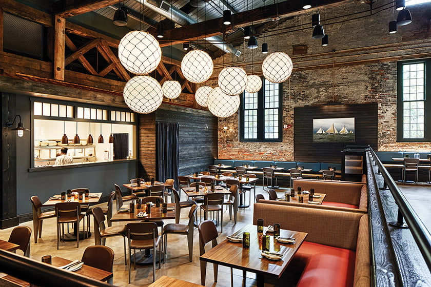Designed by Kate Giese, True Chesapeake Oyster Co.'s rustic dining room features walls of exposed brick. © Stacy Zarin Goldberg