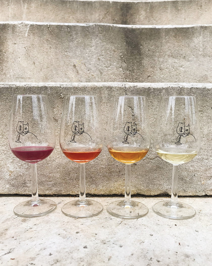Wine flights are served in whimsical glasses.