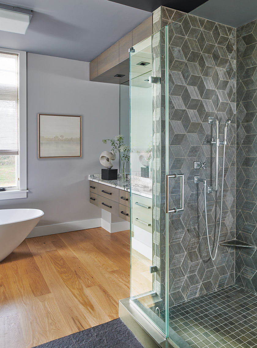 The silvery-walled master bath boasts an eye-popping tiled shower. © Anice Hoachlander