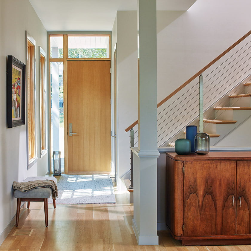 The oak entry door opens into a foyer that leads past the stairway an into the great room.