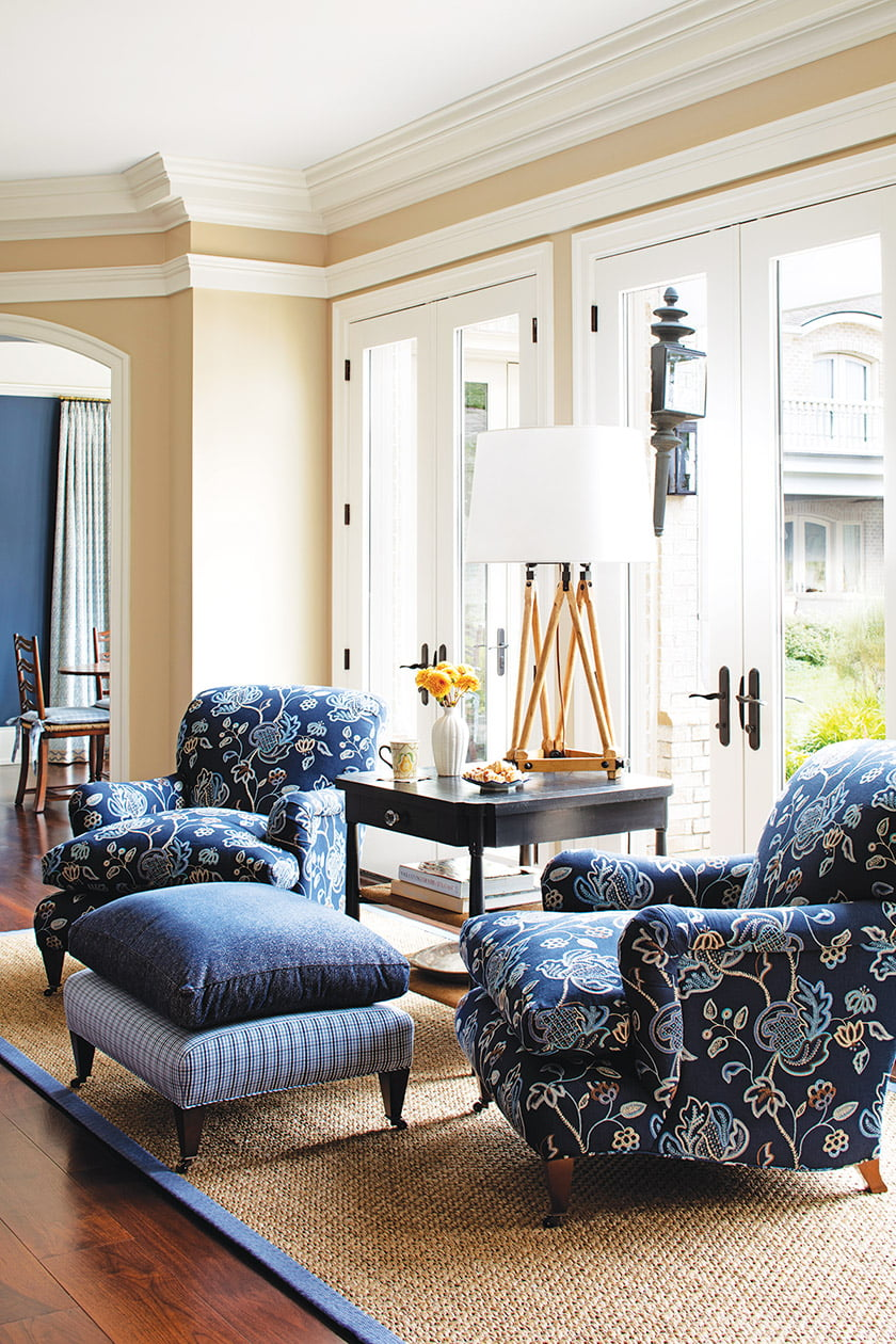 Hickory Chair armchairs in a Lee Jofa textile enhance a small seating area in the kitchen.
