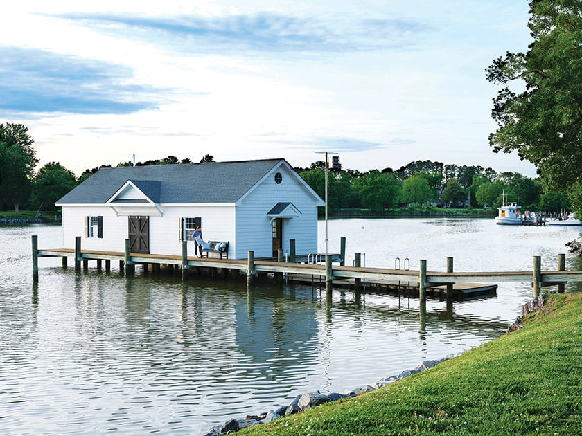 A private dock and boat house constituted must-haves for this family of sailing enthusiasts.