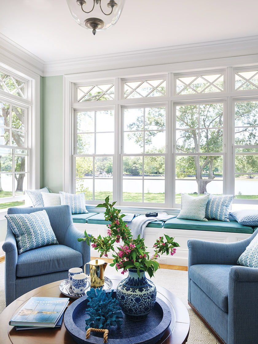 Wrapped in a soft-green Cole & Son wall covering, the library is the wife's favorite spot for morning coffee.