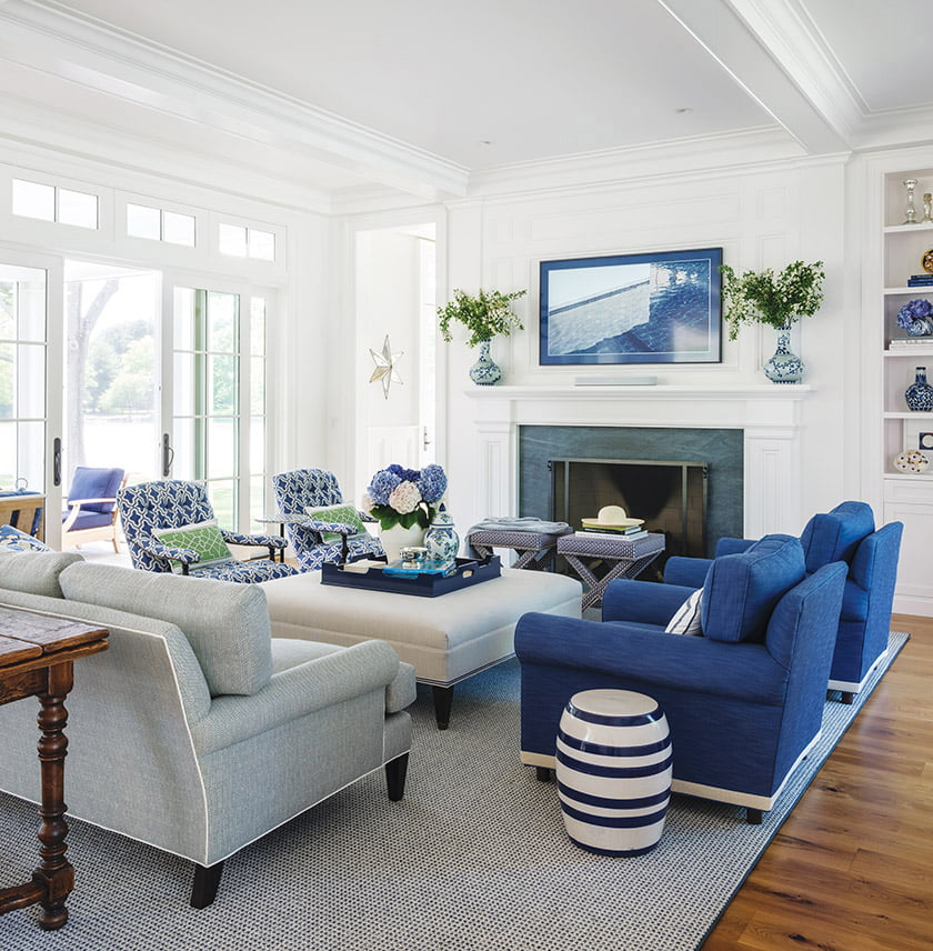 In the living area, club chairs are covered in durable, marine-blue fabric from Perennials.