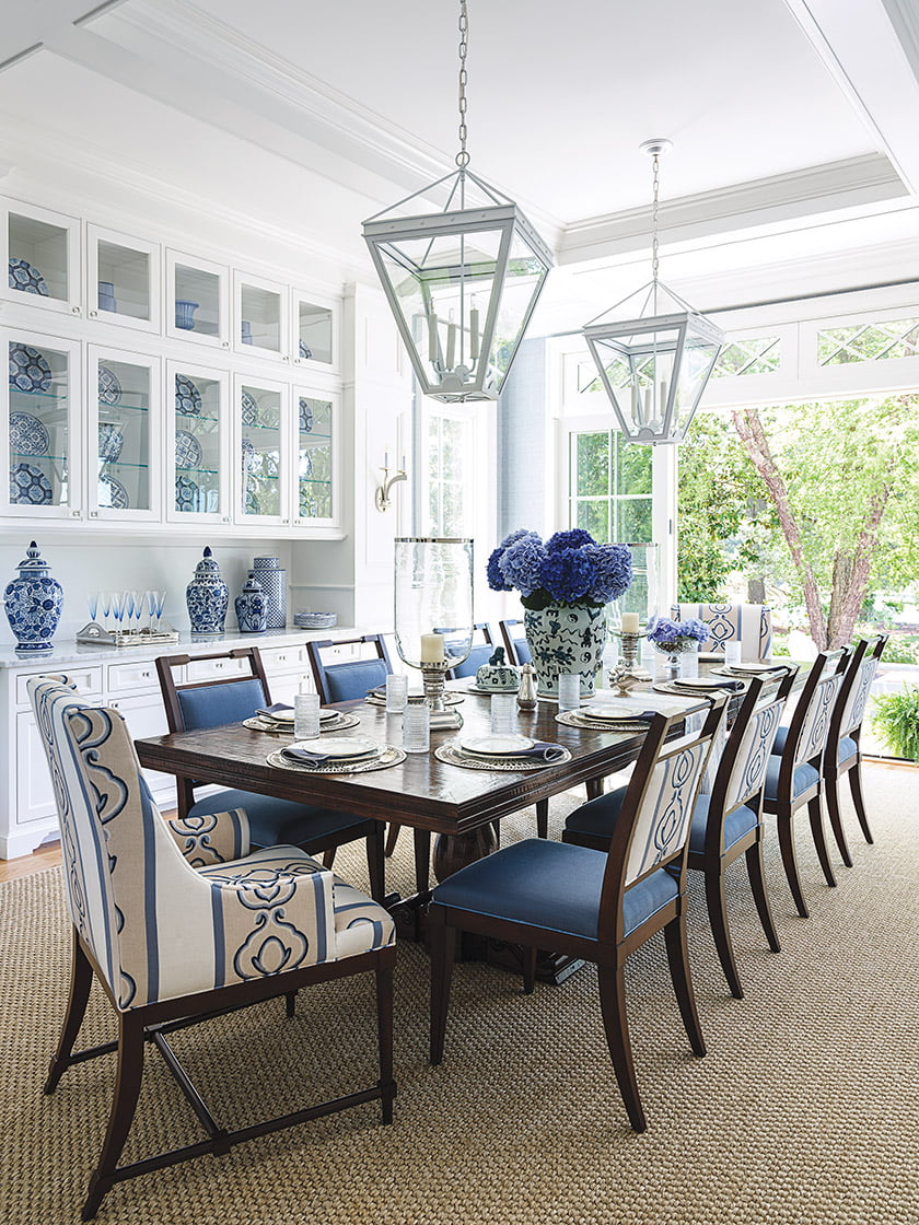 In the dining room, a Century table seats a crowd. Chairs  are covered in a Perennials solid with accents of a Cowtan & Tout print.