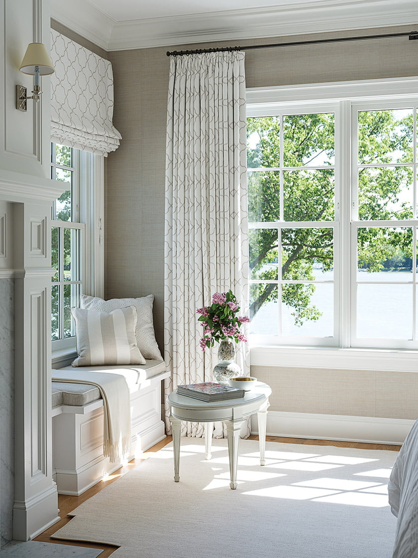 Bespoke window dressings, crafted by Everett Design here and throughout the home, frame water views.