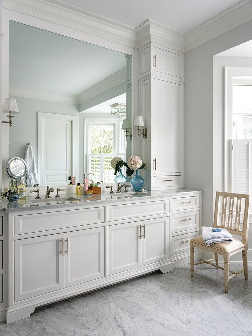 Carrara marble floors lay a luxurious foundation in the master bathroom; the custom vanity is from Lyndon Heath Cabinetry.