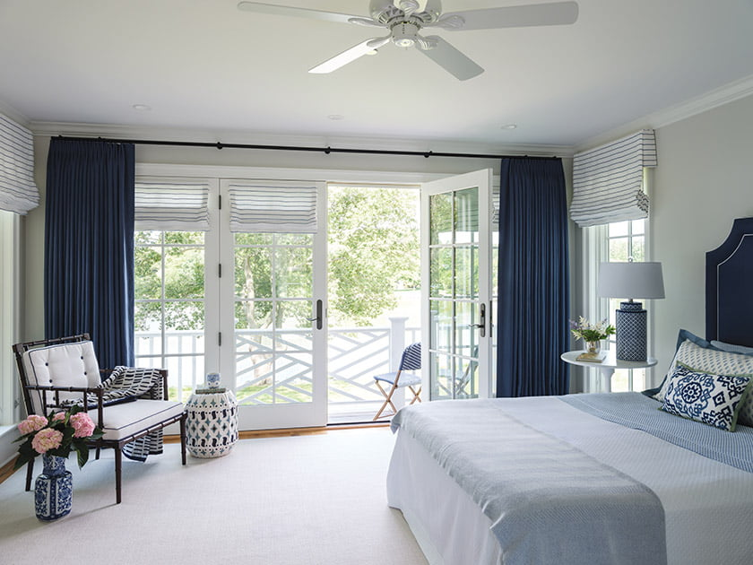 French doors in the upstairs guest room open to a private balcony.