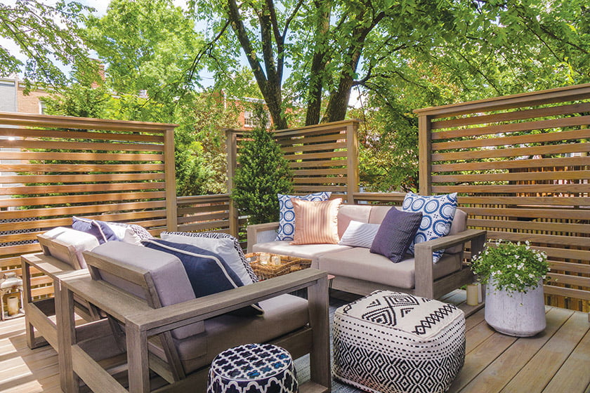 Comfortable seating is concealed by privacy screens on the deck.