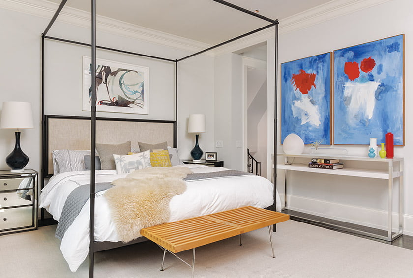 In the master bedroom, a Herman Miller Nelson Bench sits at the foot of an RH bed.