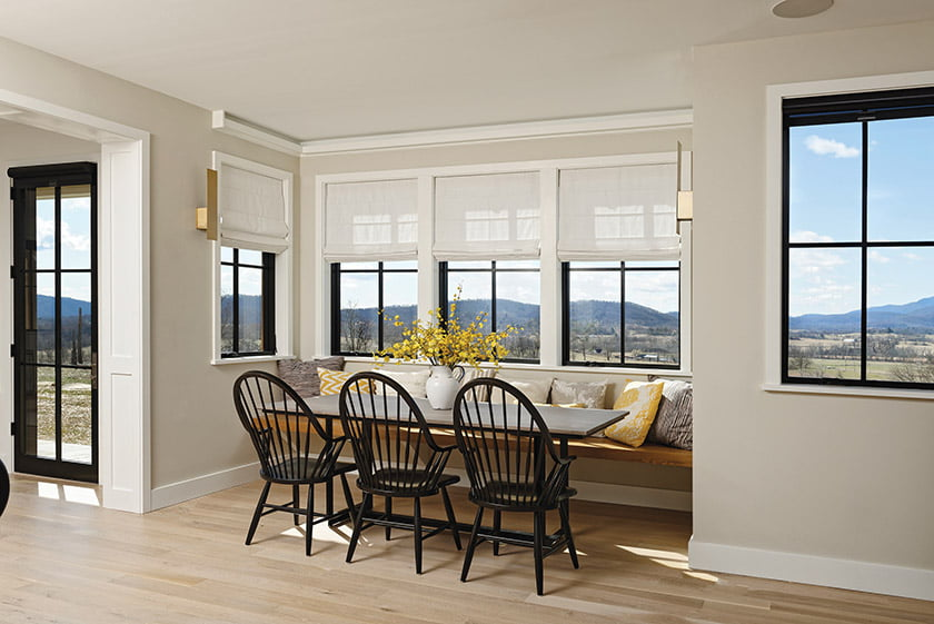 A dining nook with a built-in bench enjoys panoramic views.