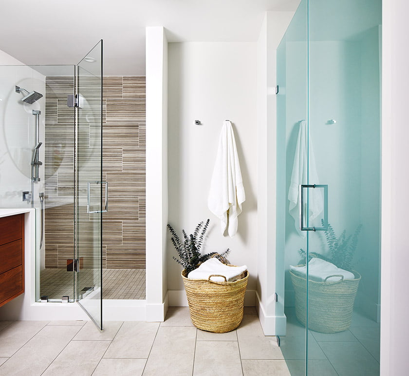 A frosted-glass partition maintains privacy in the WC.