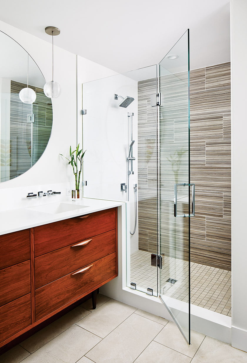 The shower in the enlarged master bath is lined in tile made with compressed newspapers.