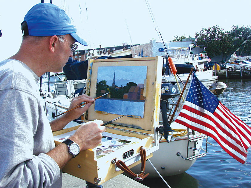An artist depicts a harbor scene during Annapolis Arts Week.